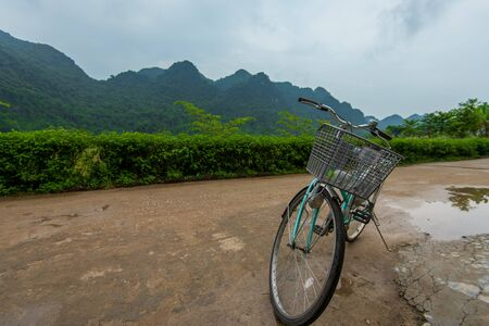 Cat Ba, Vietnam - 15th October 2019: A pushbike stood stationary against the beautiful backdrop of Cat ba Island on Ha Long Bay, Northern Vietnam