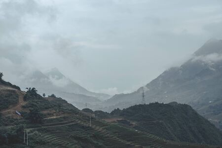 Beautiful landscape images of Sapa and the surrounding mountains with their peaks poking out of clouds