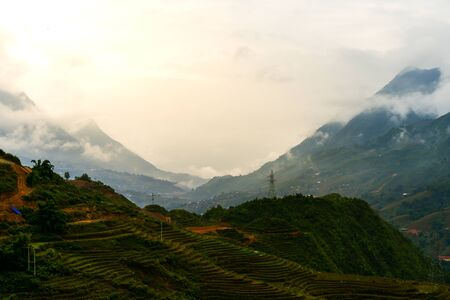Beautiful landscape images of Sapa at sunrise and the surrounding mountains with their peaks poking out of clouds
