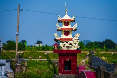 A field full of small little wayside shrines near rice terraces in Northern Vietnam, Asia