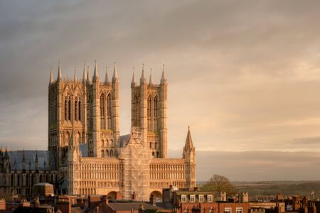 Vista shot of Lincoln cathedral as it undergoes repairs to the outside showing scaffolding Фото со стока