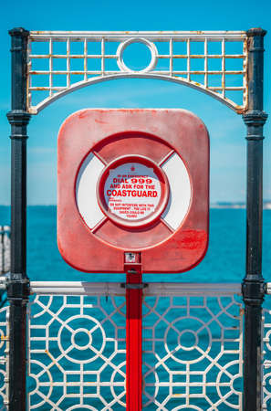 A life ring on Brighton Pier with the sea in the background Reklamní fotografie