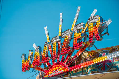 Waltzer sign made out of light bulbs with blue sky in background during summer 免版税图像