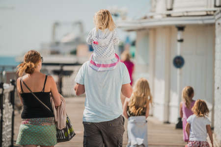 Family of 6 enjoy a day out at Brighton Beach Pier