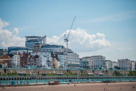 BRIGHTON, UK - 22ND JULY 2020: Brighton beach shot from the pier during a hot summer day in 2020 during the Covid-19 Pandemic 新闻类图片