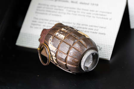 A British WW2 grenade on display in a museum. Old and rusty