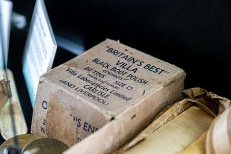 Aldershot, UK - 5th September 2020: Box of black boot polish used by the British Army in WW2 on display in a museum