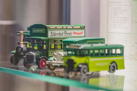 Aldershot, UK - 5th September 2020: Old vintage model bus toys from Aldershot on display in a museum in Hampshire UK