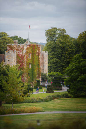 Kent, UK - 30th October 2020: Hever Castle shot in the Summer of 2020 during the pandemic on a bright sunny day as flowers bloom around the beautiful grounds Redakční