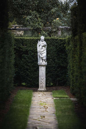 Beautiful stonework statue of a priest in the castle of Hever Castle in Kent, UK Reklamní fotografie
