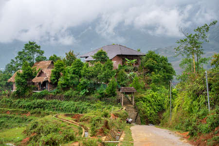 Small rural house on the side of rice paddies along Sapa dirt road in Northern Vietnam. October 2019