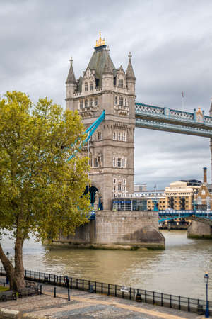 London, UK - 27th September 2020: London Tower Bridge on River Thames shot on a cold cloudy day from Tower of London