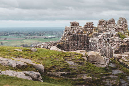 Dramatic images of Beeston Castle Remains in Cheshire, UK on cloudy winter day