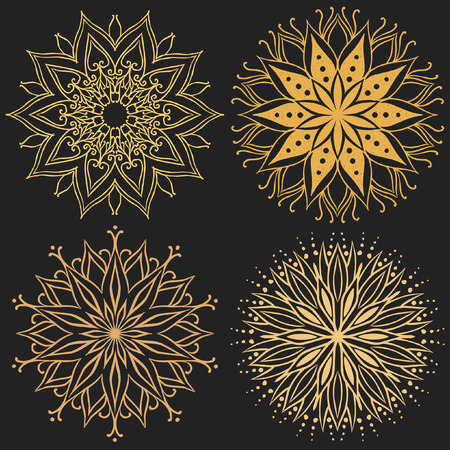 Gold mandalas on black background