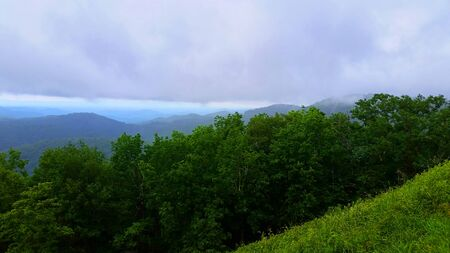 Blue Ridge Appalachian Mountain View Scene with Trees and Bushes, Grass, Sky, Clouds, Rocks, Boulders