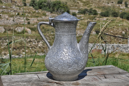 relict: Silver ancient pitcher with arabic ornaments was founded in Caucasus Stock Photo
