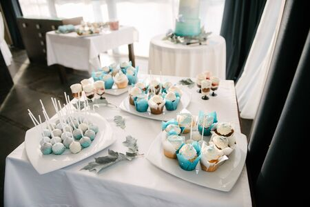 Sweet dessert table at a wedding.Cakestand at a wedding day