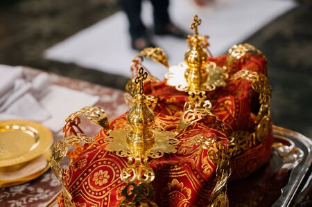Two crowns for weddings on a tray in a church close up