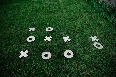 tic tac toe game in the fresh air, playing on the grass