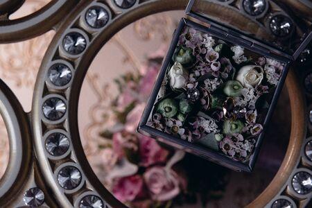 Wedding rings lie on a flower