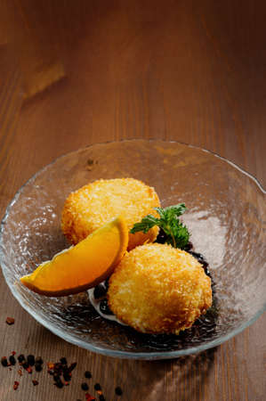Potato croquettes - mashed potatoes balls breaded and deep fried, served with different sauce.Top view