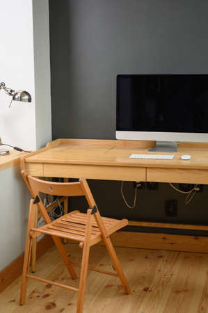 Photographer's workplace with professional camera and computer.Workplace with computer, laptop and camera on wooden table Imagens