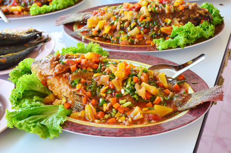 sweet and sour: fried Tilapia topped with sweet ,sour and hot sauce Stock Photo