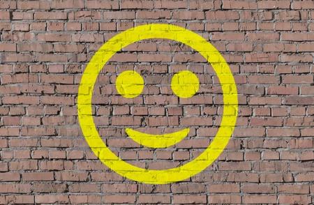 graffiti brown: Smile on brick seamless wall