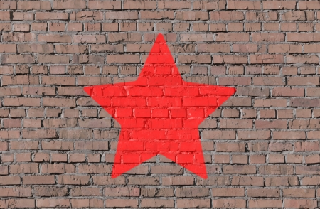 Star shape on brick seamless wall photo