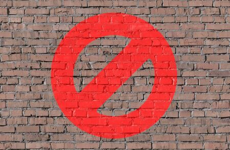 Stop sign on brick seamless wall photo