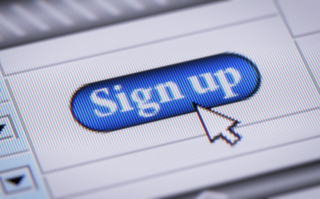 signup: sign up button on monitor Stock Photo
