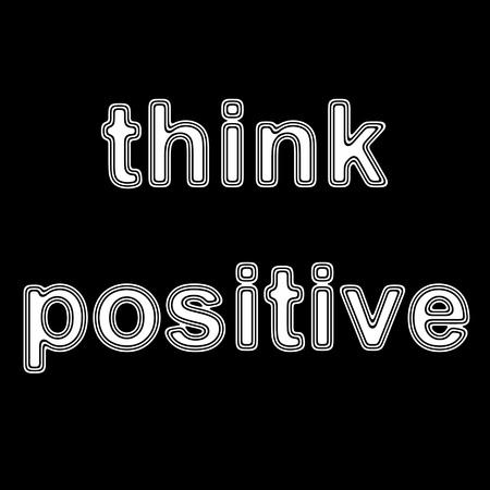 'Positief denken' op een zwarte achtergrond.