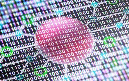 Circuit board and binary code in the screen. 스톡 콘텐츠