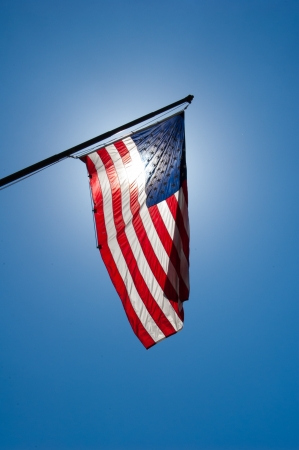 The American Flag with the sun behind  Reklamní fotografie