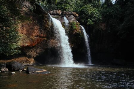 Haew Suwat boasts breathtaking streams of water freefalling over a roughly 20-metre-high ledge into a circular pool. Stock Photo