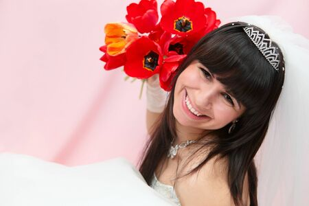 homogeneous: bride with tulips on a homogeneous background  Stock Photo