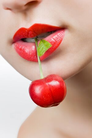 Young beautiful girl holding a cherry Stock Photo