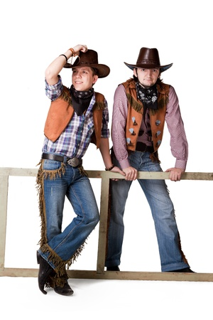 Portrait of two cowboys to the utmost isolated on a white background