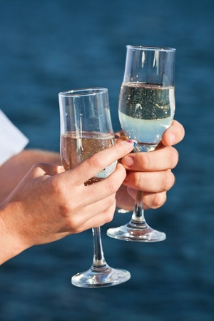 man and woman hands holding champagne glasses photo