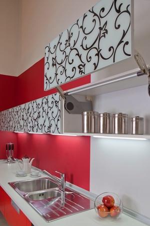Modern kitchen interior with red decoration photo
