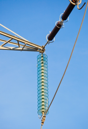 High voltage transmission power line and glass isolators photo