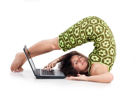 flexible beautiful girl with the laptop on a white background photo