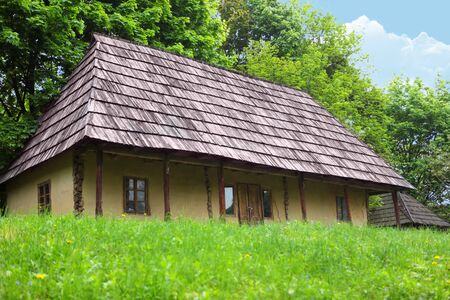 Old wooden house in village. The wooden house located on the fringe of the forest. photo