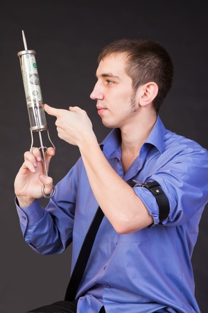Anti-recessionary injection  vaccination  by one dollar denomination Stock Photo - 13791499