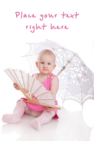 child with umbrella and fan isolated on white background photo