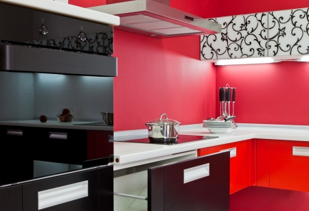 Modern kitchen interior with red decoration Stock Photo - 14613449