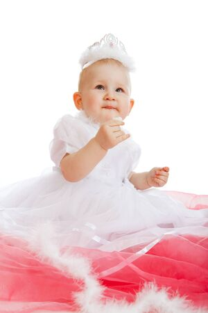 Happy playful little girl on the floor, white background photo
