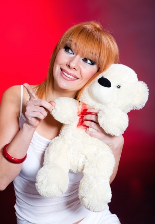 Young woman with teddy bear photo