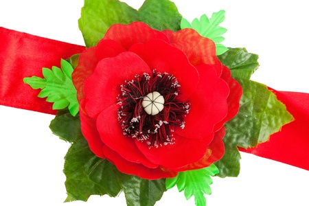 Red tape with a poppy from a fabric photo