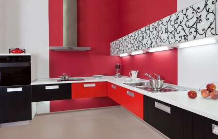 Modern kitchen interior with red decoration photo